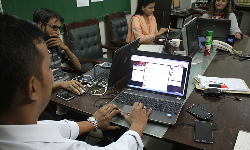 MQM's social media team busy at work at the party's Cyber Communications Department — Photo by author