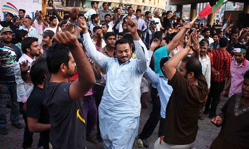 MQM supporters dance to celebrate victory of their candidate for NA-246, Kunwar Naveed Jamil. -ONLINE