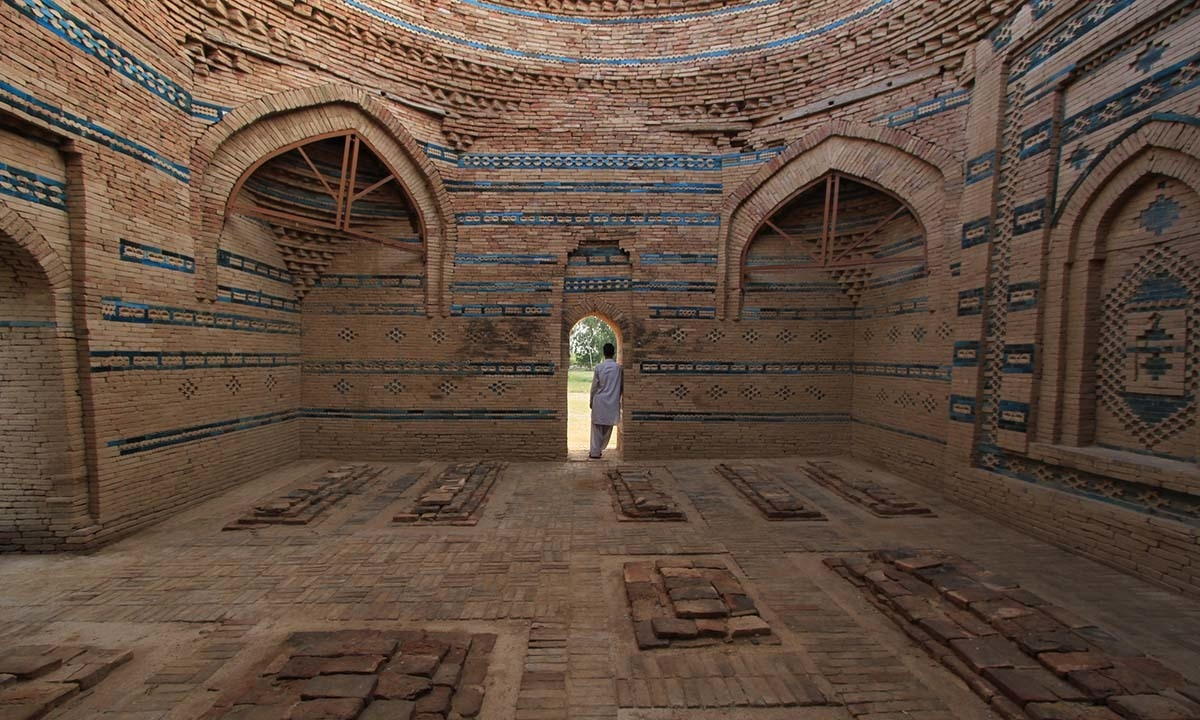A man stands inside the Lal Marah tombs