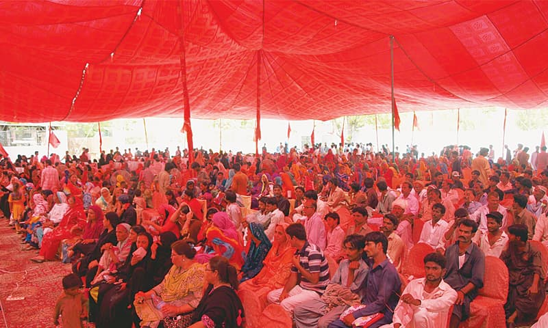 AUDIENCE at the Sindh Hari Mazdoor Conference held in Hyderabad on Sunday.—Dawn