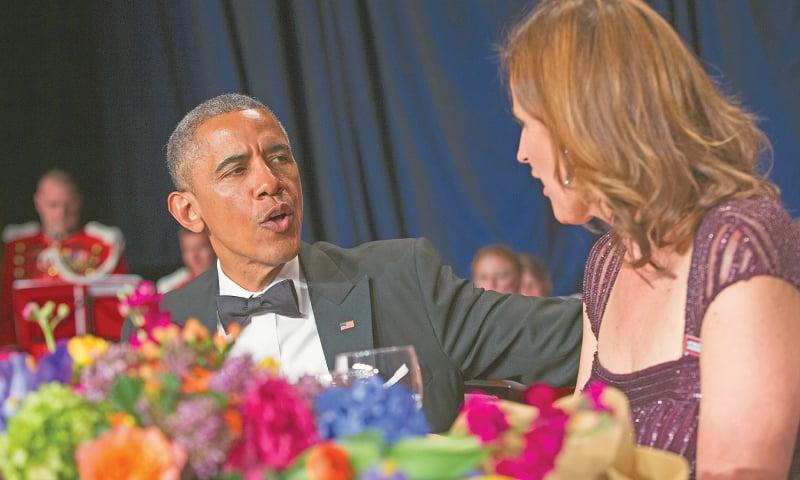 Washington: President Barack Obama talks with White House Correspondents Association president Christi Parsons during the White House Correspondents Association dinner at the Washington Hilton on Saturday.—AP