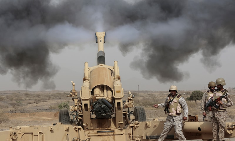 Saudi soldiers fire artillery toward three armed vehicles approaching the Saudi border with Yemen. ─ AP/File