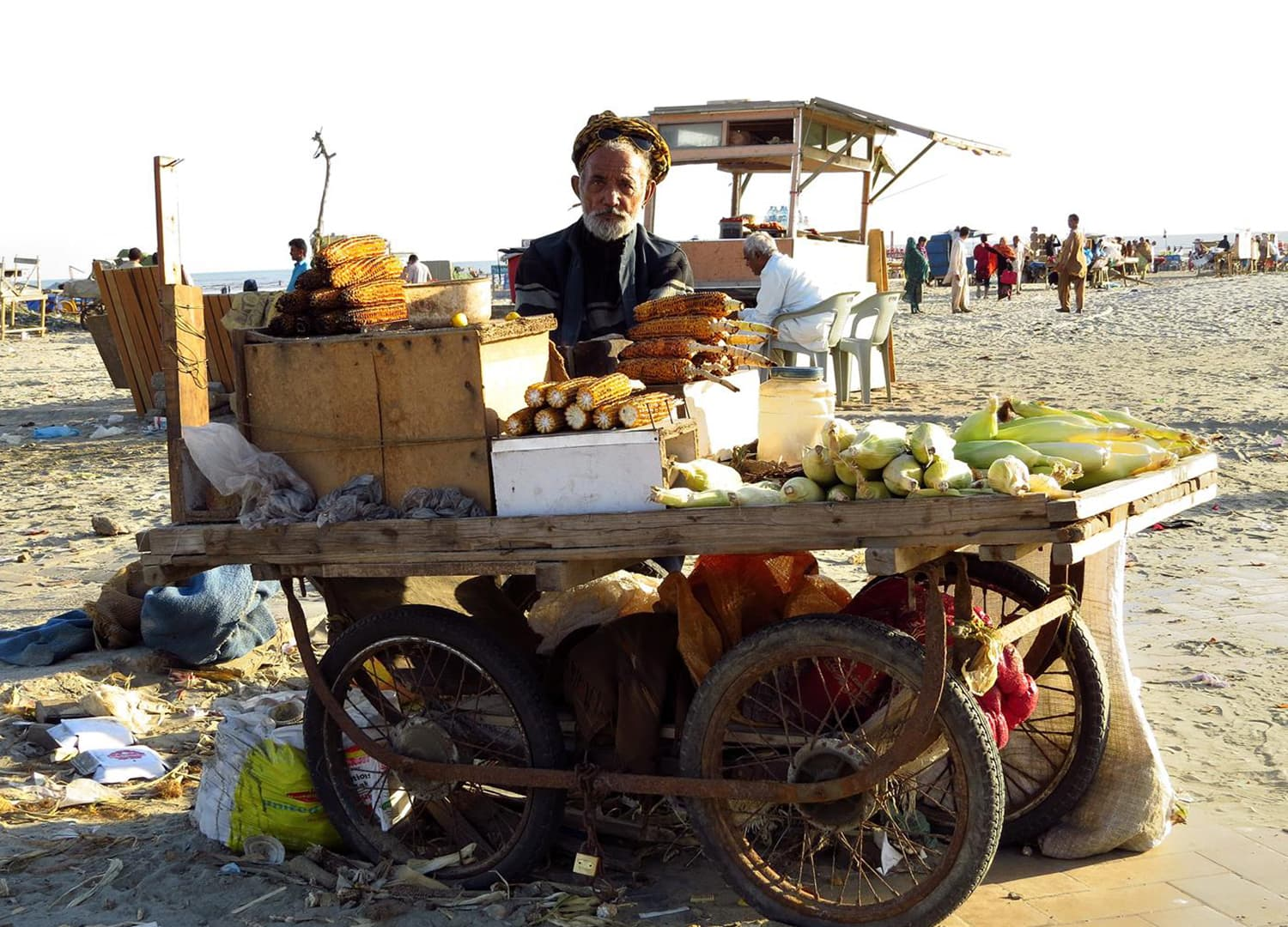 A corn vendor at the beach.