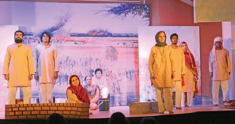 A scene from the play Dagh Dagh Ujala staged in Islamabad. — Photo by Khurram Amin