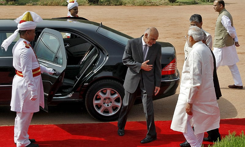 Ashraf Ghani gestures as he prepares to leave after attending his ceremonial reception at the forecourt of India's presidential palace Rashtrapati Bhavan, in New Delhi. ─ Reuters