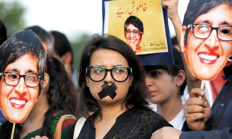 A civil society activist taped her mouth during the protest on Tuesday. — White Star