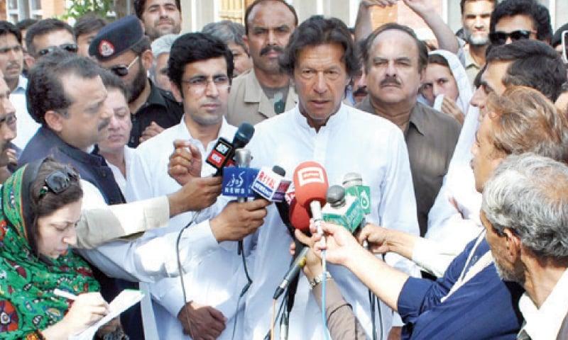 Imran Khan talks to media persons at LRH, Peshawar, on Tuesday. — INP