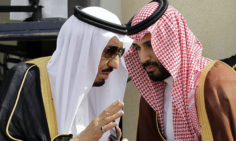 King Salman speaks with his son Prince Mohammed, who he appointed as the deputy crown prince on Wednesday. —AP/File