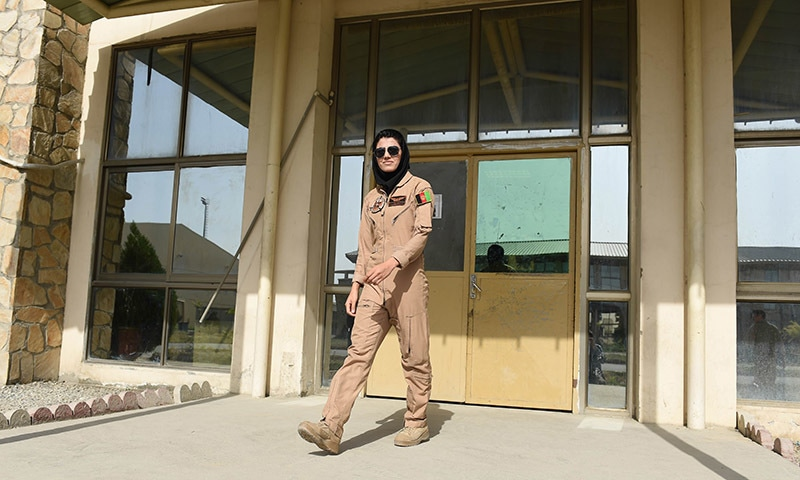 In a picture taken on April 26, 2015, Afghanistan's first female pilot Niloofar Rahmani, 23, leaves her office at an Air Force airfield in Kabul. — AFP