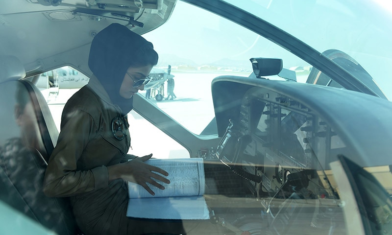 Niloofar Rahmani, 23, sits in a fixed-wing Afghan Air Force aviator aircraft in Kabul. — AFP