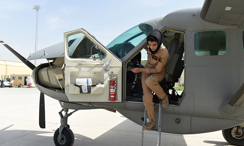 Afghanistan's first female pilot Niloofar Rahmani, 23, exits a fixed-wing Afghan Air Force aviator aircraft in Kabul. — AFP