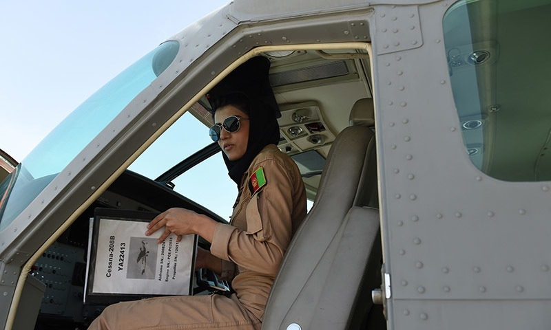 Afghanistan's first female pilot Niloofar Rahmani, 23, sits inside a fixed-wing Afghan Air Force aviator aircraft in Kabul.— AFP