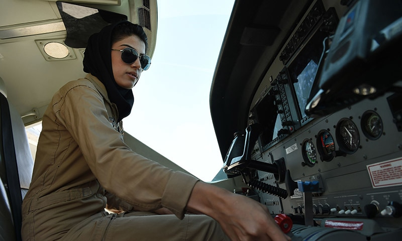 In a picture taken on April 26, 2015, Afghanistan's first female pilot Niloofar Rahmani, 23, sits in a fixed-wing Afghan Air Force aviator aircraft in Kabul. — AFP