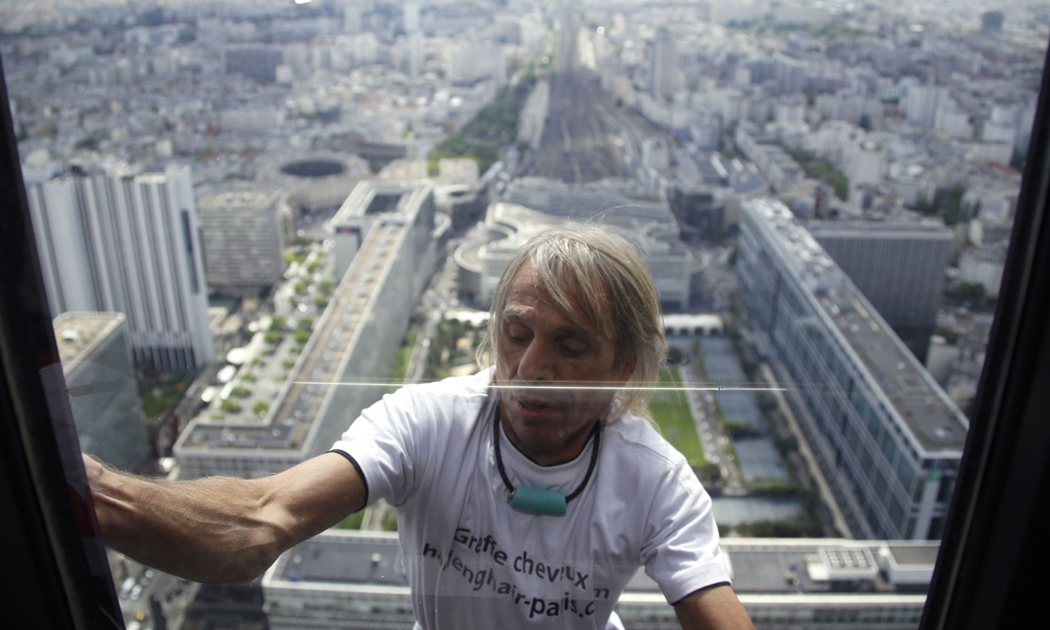 Alain Robert, the French urban climber dubbed Spiderman, climbs the 210m (689 ft) Tour Montparnasse skyscraper in Paris.– AFP