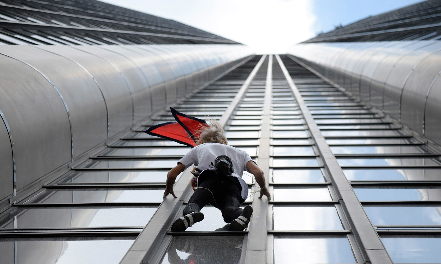 French urban climber dubbed Spiderman, climbs the 210m (689 ft) Tour Montparnasse skyscraper in Paris. – AFP