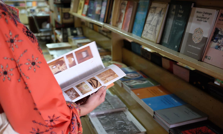 A customer at the bookstore. — Photo by Farooq Soomro