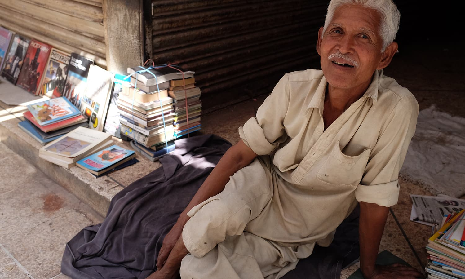 A bookseller at Regal chowk. — Photo by Farooq Soomro
