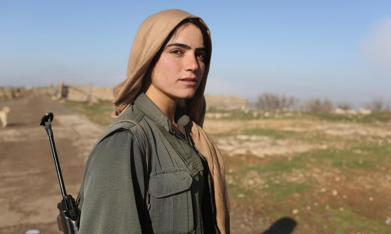 A female Kurdistan Workers Party fighter stands guard at a PKK base on Mount Sinjar in northwest Iraq.