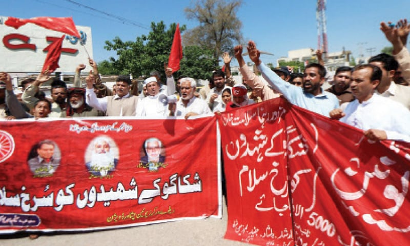 Railway workers chant slogans during a rally in Peshawar on Friday in connection with International Labour Day. —Online