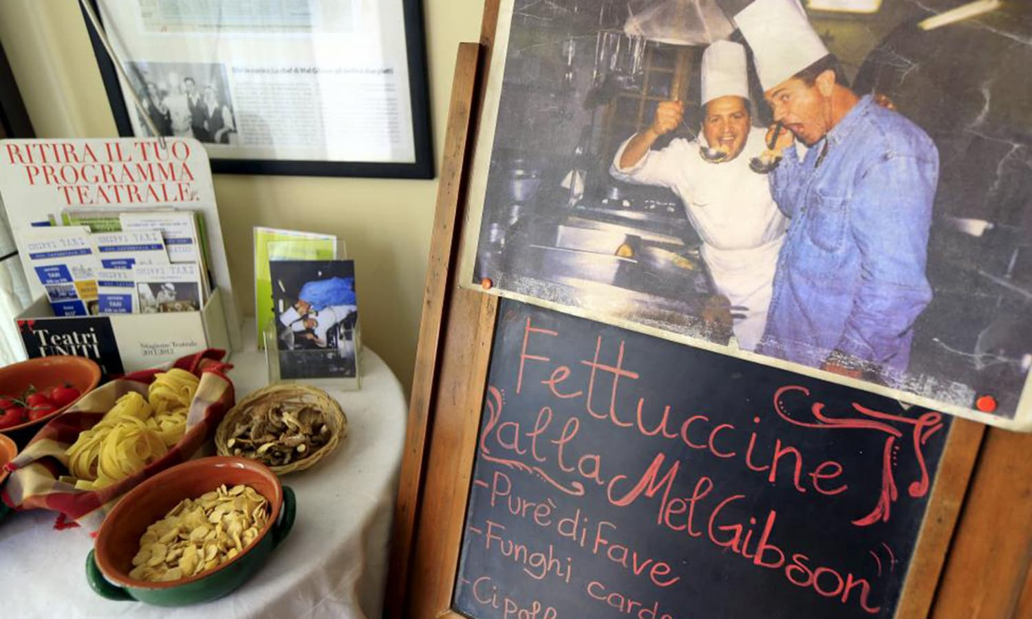 "Chef Gigi Sanrocco and actor Mel Gibson are seen in a picture posted on a blackboard at a restaurant in Matera, southern Italy April 30, 2015. The Australian-born actor is celebrated with the dish called """"Fettucine alla Mel Gibson"" in his honor at the popular Trattoria Lucana on Matera's main drag, the Via Lucana."