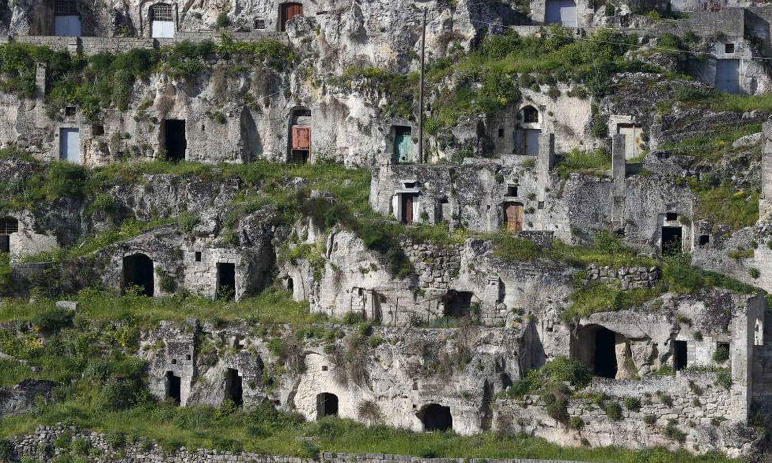 A general view of Matera's Sassi limestone cave dwellings in southern Italy April 30, 2015. The fact that until the fascist leader Mussolini's rise to power in the 1930s the caves didn't have electricity but were teeming with people who kept their livestock inside was what so shocked Levi. Post-war social planners relocated the inhabitants and perhaps most of the Sassi were left vacant.