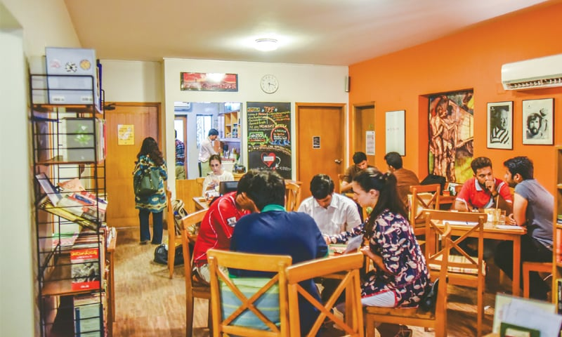 T2F regulars at their favourite haven in the city where they can study or work on their presentations. The cafe-cum-community space reopened on Sunday afternoon, after its director Sabeen Mahmud was shot dead on April 24.—White Star