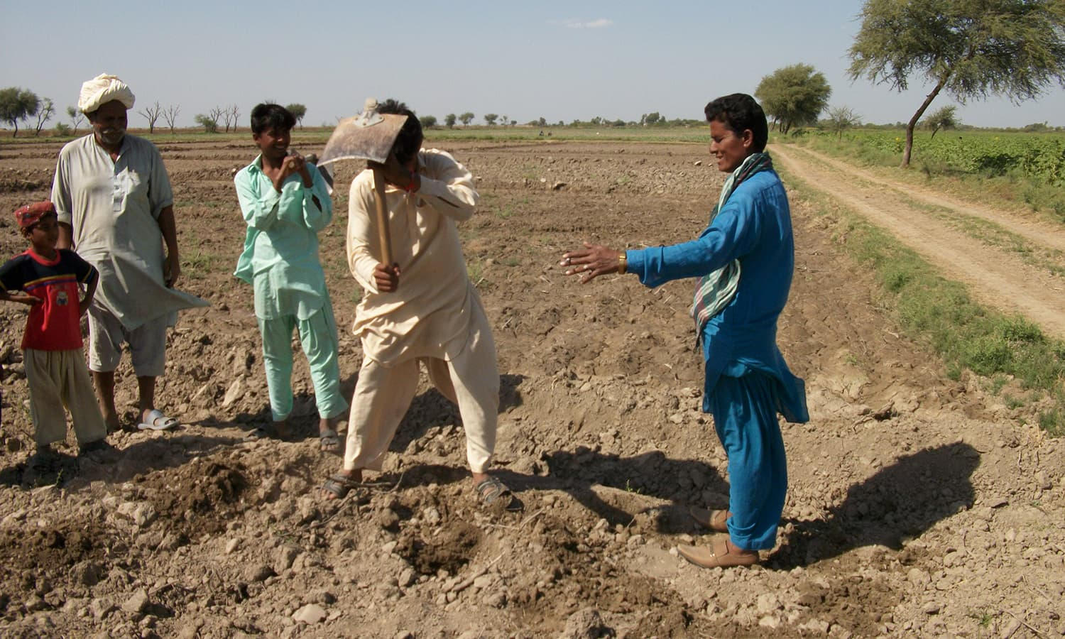 Ten years ago, Meena (extreme-right) was asked by Mr Jamali to supervise his agricultural lands. - Photo by author