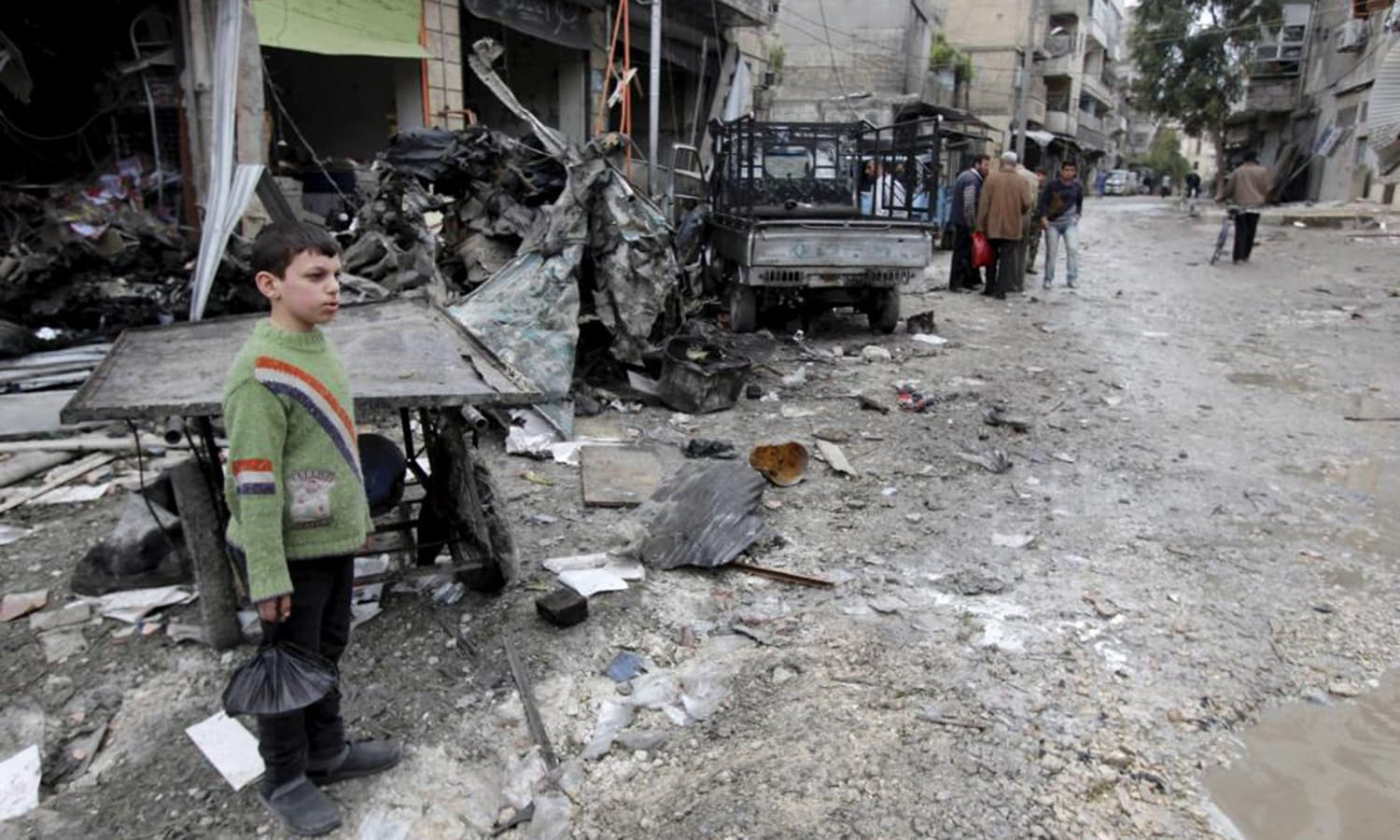 Residents inspect the damage from what activists said was due to shelling by warplanes loyal to Syria's president Bashar Al-Assad inside a vegetable market in the al-Maadi neighborhood of Aleppo.— Reuters