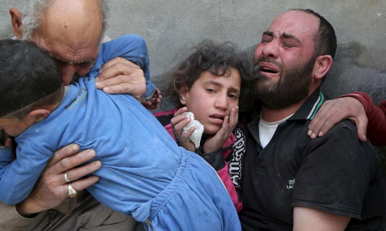 A family mourns the loss of their relatives to what activists say was a barrel bomb dropped by forces loyal to Syria's President Bashar al-Assad, in Aleppo's al-Fardous district. — Reuters