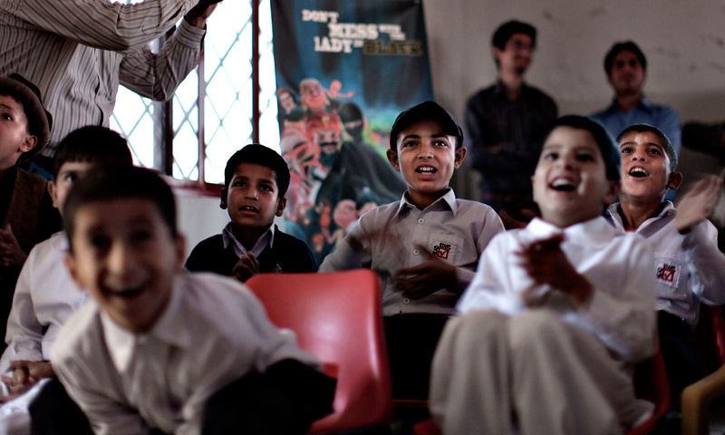 Orphaned children react while watching an early screening of the first episode of the animates Burka Avenger series, at an orphanage on the outskirts of Islamabad.