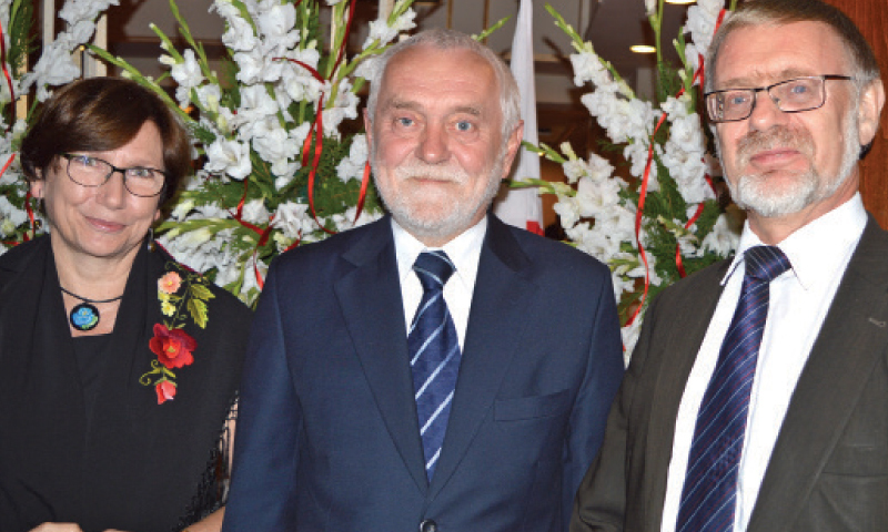 This file photo shows Polish ambassador Andrezej Ananicz (C) with his wife (L) and Ambassador of Norway Leif Larsen (R). — Dawn/File