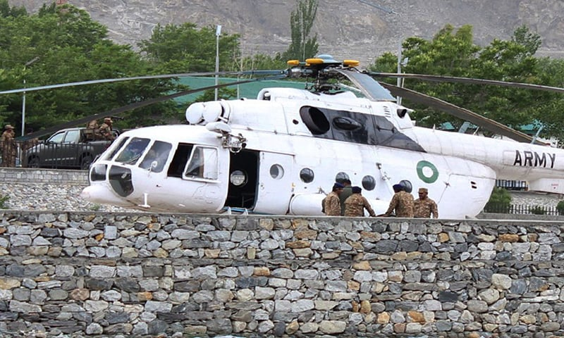Pakistani soldiers gather beside an army helicopter at a military hospital where victims of a helicopter crash were brought for treatment in Gilgit. — AFP