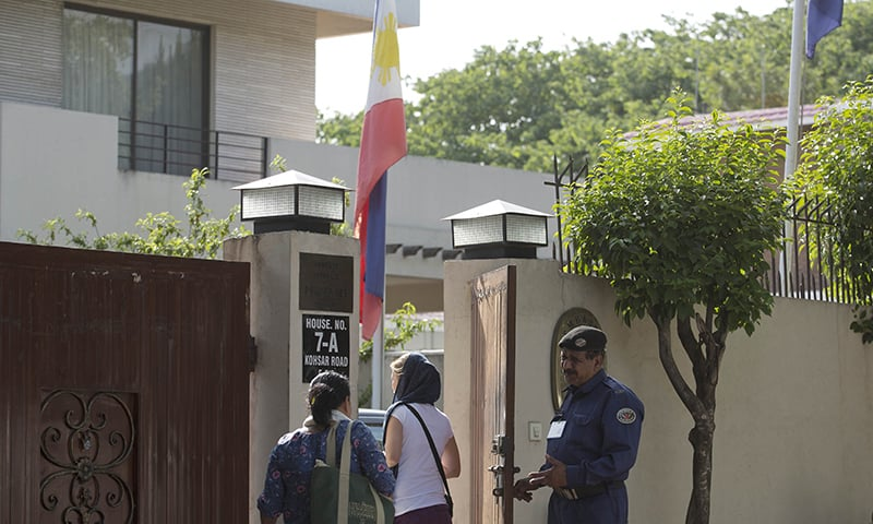 People visit the embassy of the Philippines where the national flag is at half-mast mourning the reported death of Ambassador Domingo Lucenario Jr in Islamabad. —AP