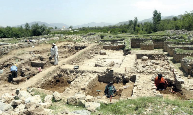 Excavations being carried out at the newly discovered stupa at Badalpur near Taxila. The other pictures are of the discoveries unearthed.  — Dawn