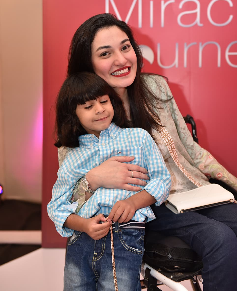 Seen here with her son, Muniba Mazari moved the audience at Pond's Miracle Journey with her story of astounding perseverance. — Publicity photo