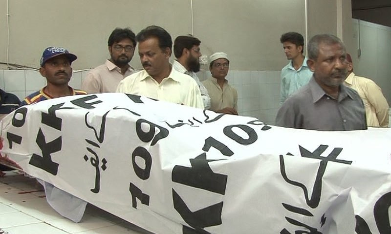 The body of Dr Anwar Ali Abidi who was shot dead by unknown assailants in Karachi's Nazimabad area. — DawnNews screengrab