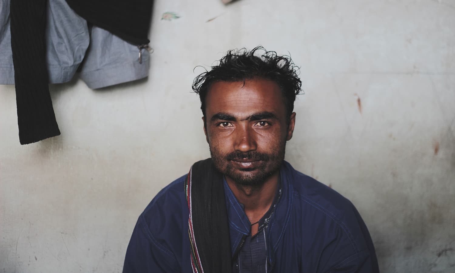 "Abdullah, 28, returned from a fishing trip empty handed a night before; ""It's just a bad season"" he says."