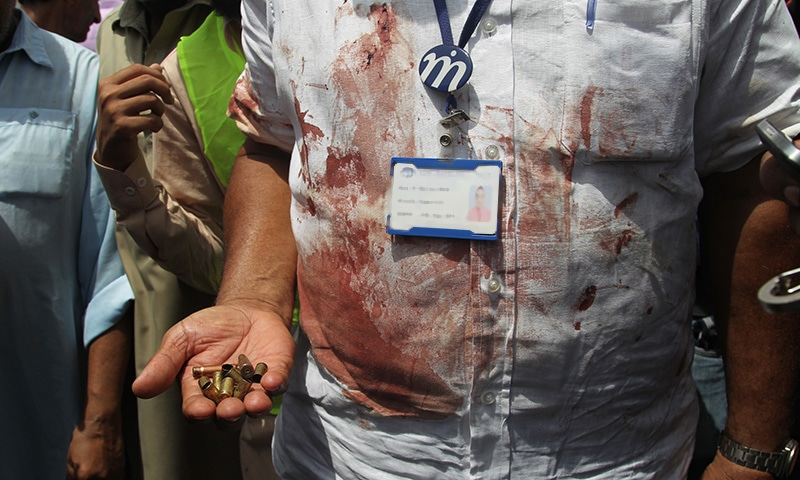 A rescue official displays casings collected from the scene of an attack on a bus, in Karachi, Pakistan, Wednesday, May 13, 2015. — AP/File