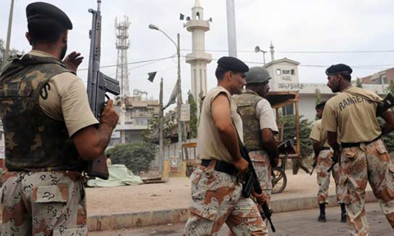 Safoora Goth tragedy put a question mark over the Rangers-led targeted operations across the city.—AFP/File