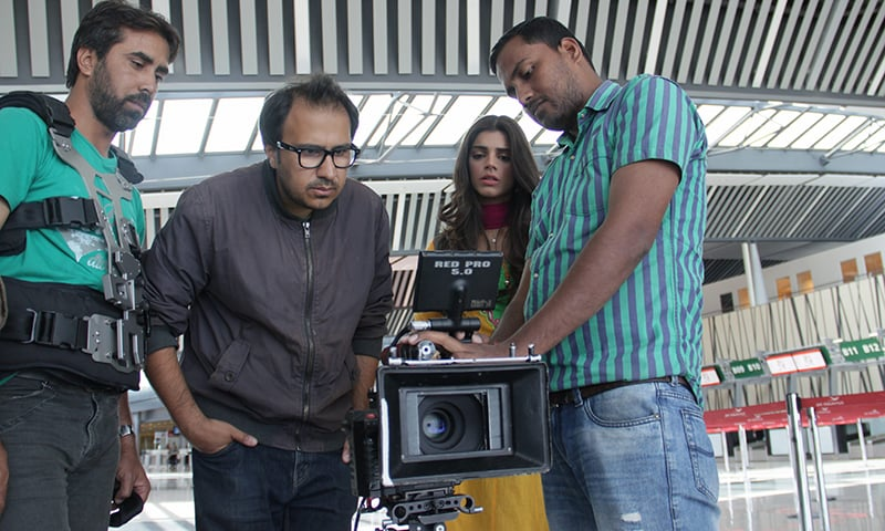Director Nasir Khan reviews a scene of Bachaana with Sanam Saeed — Publicity photo