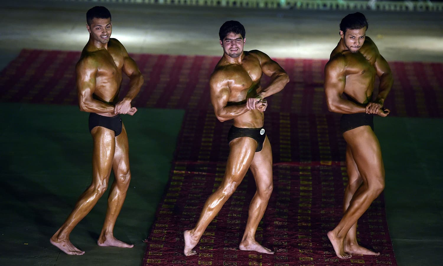 Bodybuilders at the Mr Islamabad competition. — AFP