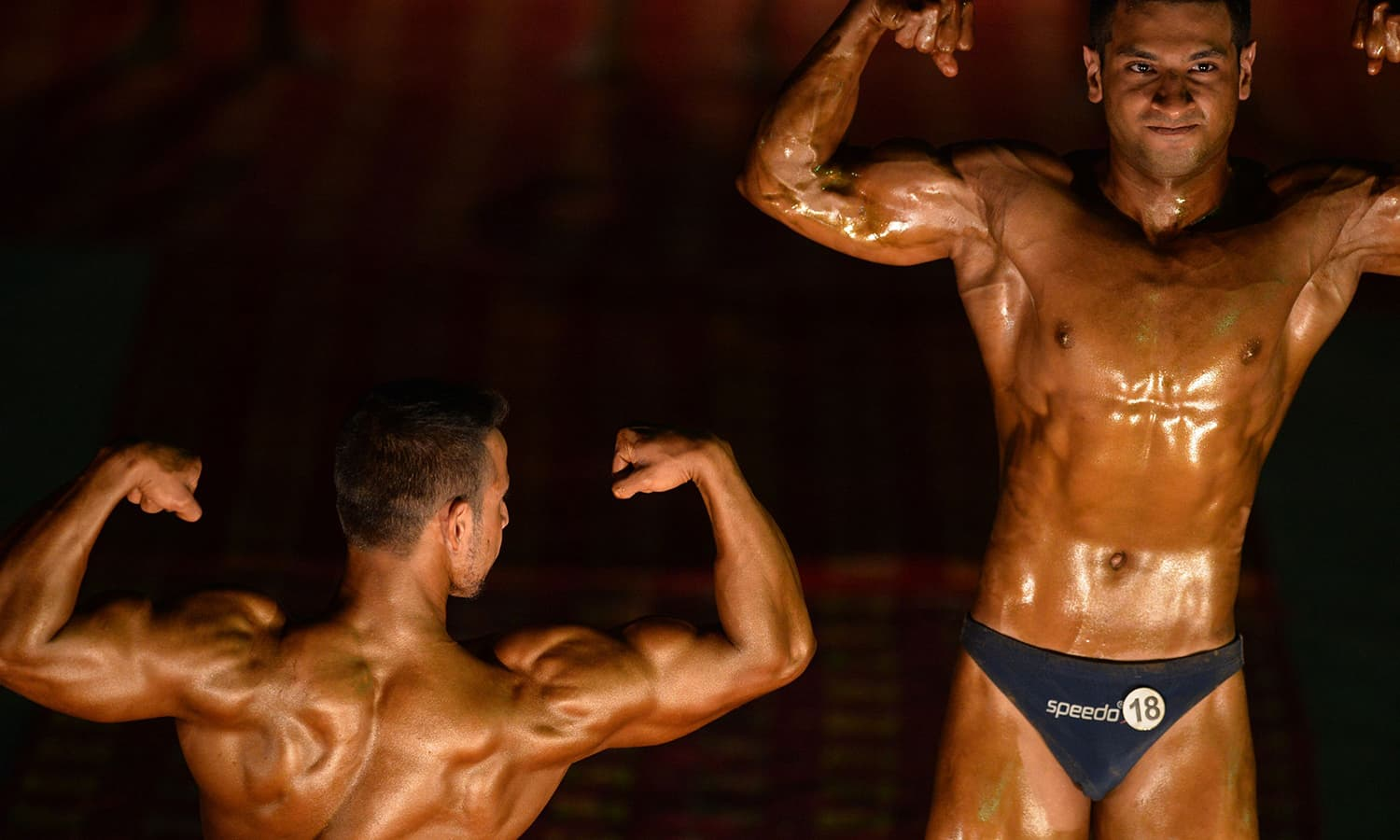 Bodybuilders perform during the competition. — AFP