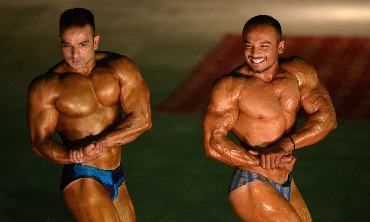 Bodybuilders compete during a local Mr Islamabad and junior Mr Islamabad competition in Islamabad on May 15, 2015. — AFP