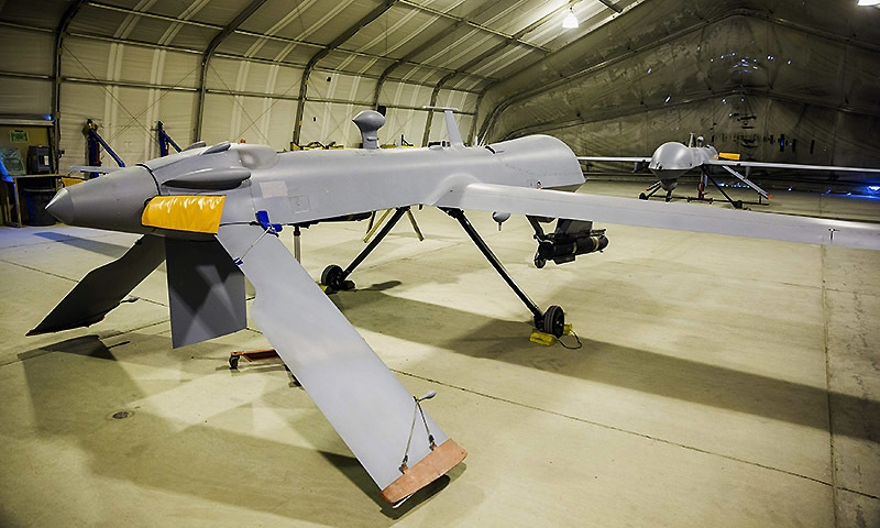 Two MQ-1B Predator Unmanned Aerial System vehicles that are part of Task Force Odin, stand inside a hangar at Bagram Air Field in the Parwan province of Afghanistan January 3, 2015. REUTERS/Lucas Jackson (AFGHANISTAN - Tags: CIVIL UNREST POLITICS MILITARY CONFLICT)