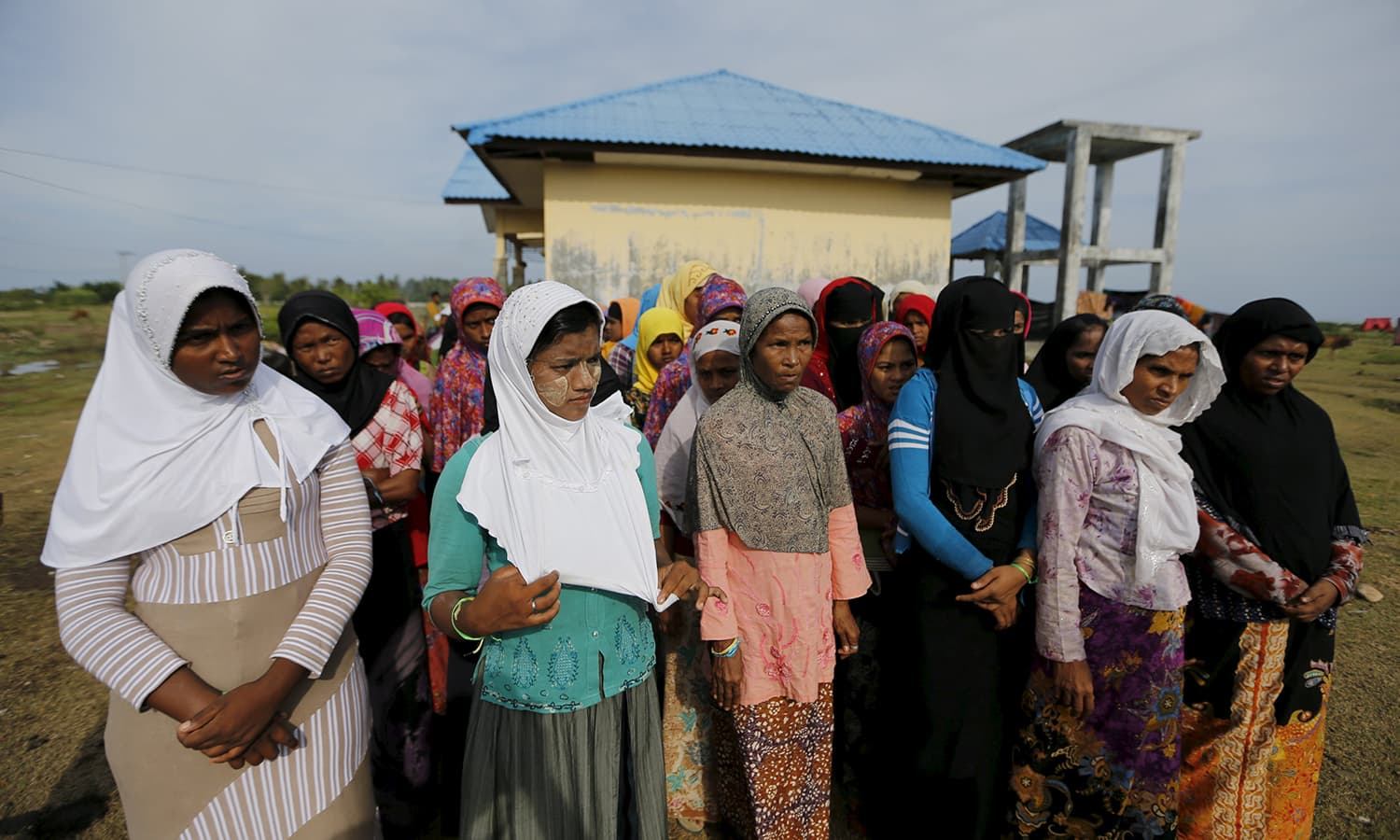 Rohingya migrants who arrived in Indonesia by boat queue for breakfast inside a temporary compound for refugees at Kuala Cangkoi village in Lhoksukon, Indonesia's Aceh.