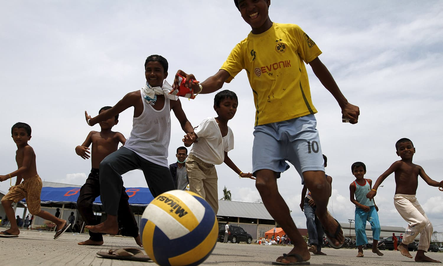 Rohingya children, who arrived in Indonesia by boat, play soccer outside a shelter in Kuala Langsa, in Indonesia's Aceh Province.