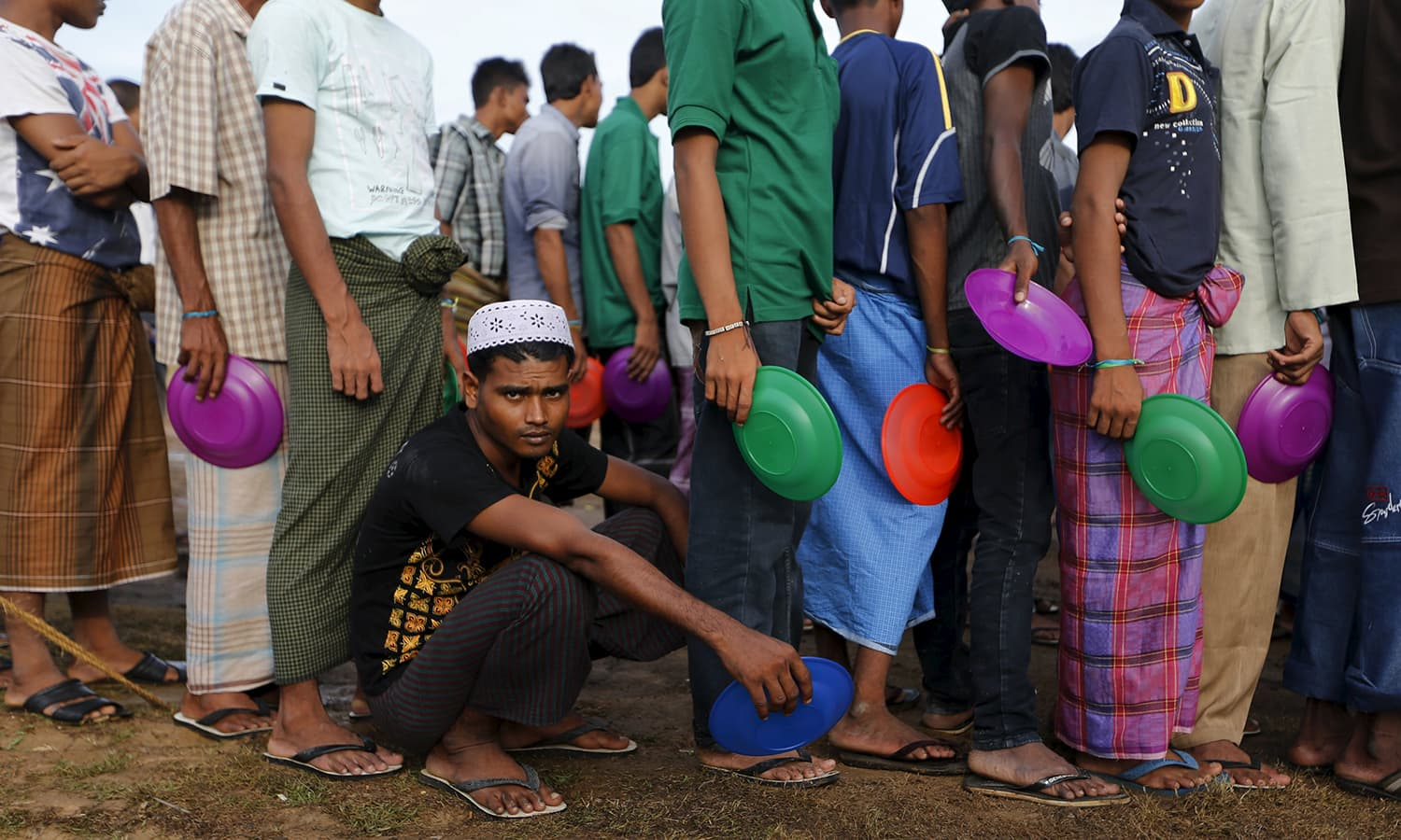 Rohingya migrants who arrived in Indonesia by boat queue for breakfast inside a temporary compound for refugee at Kuala Cangkoi village in Lhoksukon, Indonesia's Aceh.