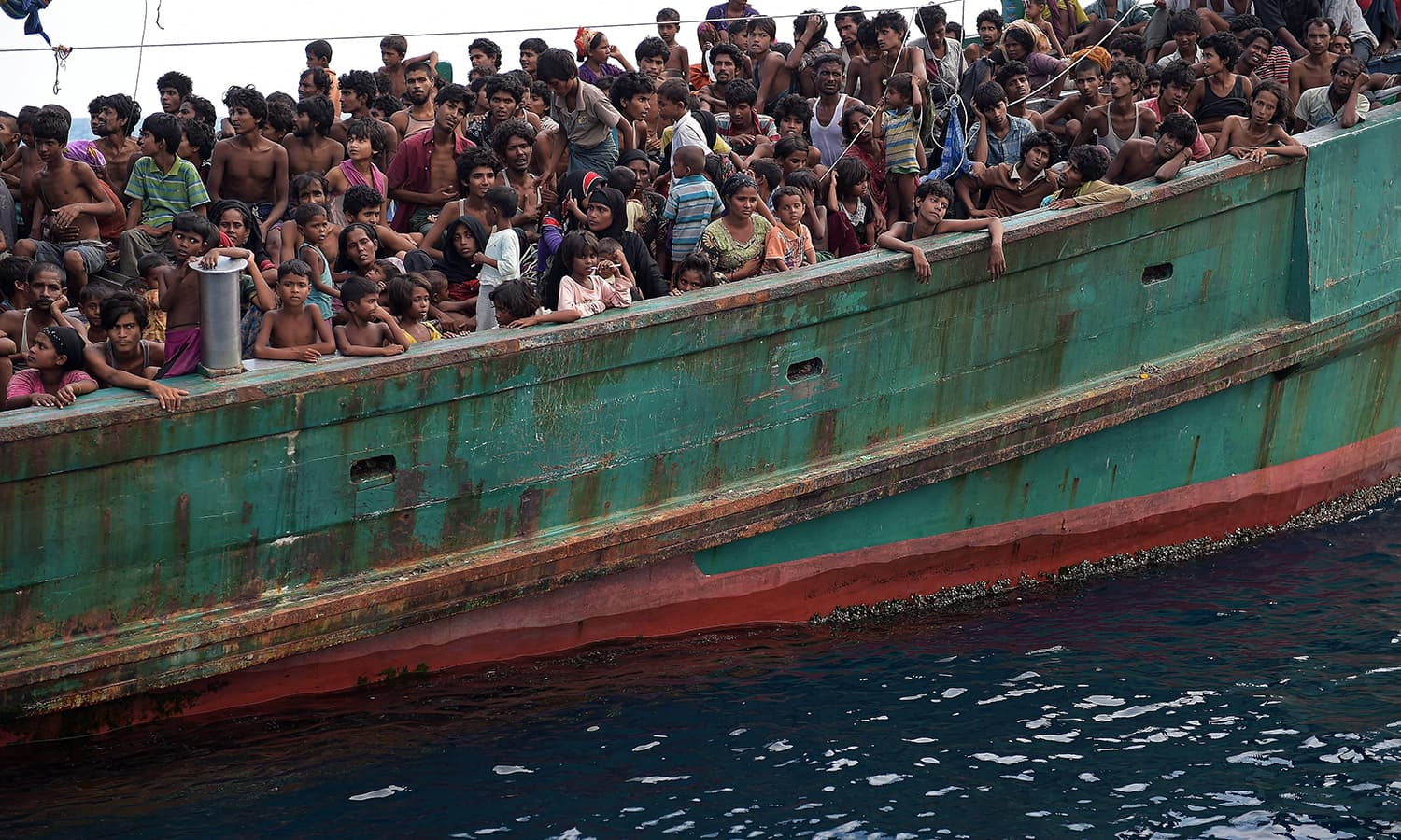 Rohingya migrants on a boat drifting in Thai waters off the southern island of Koh Lipe in the Andaman.  Trafficking experts say Thailand is the centre of a multi-million-dollar trade run by competing transnational criminal syndicates. AFP