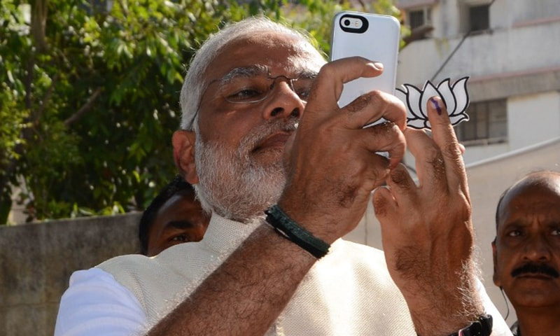 Indian Chief Minister for the western state of Gujarat and Bharatiya Janta Party (BJP) prime ministerial candidate Narendra Modi takes a 'selfie' after casting his vote at a polling station in Ahmedabad on April 30, 2014. —AFP/File