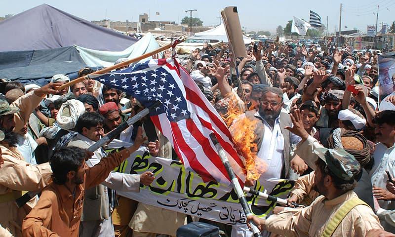 Supporters of Jamiat Ulama-e-Islam burn an American flag to condemn the killing of Osama bin Laden, in Kuchlak | AP